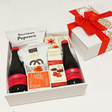 Xmas gift basket with lindauer & fruit cake slice pesented in a modern gift box.