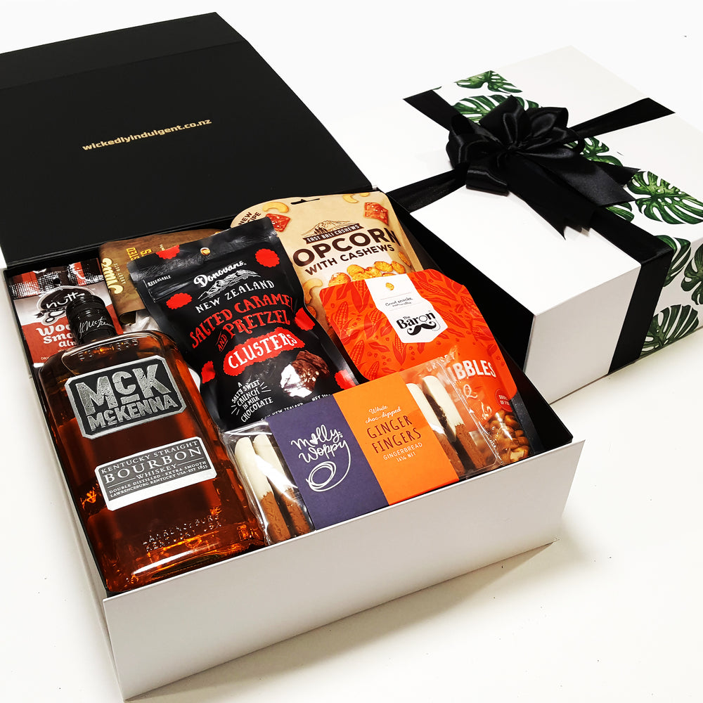 Mr Mckenna Bourbon gift basket with chocolate, nuts, popcorn and gingerbread presented in a modern gift box.