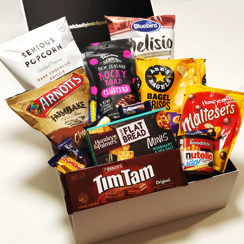 Mum-a-licious mothers day gift basket with tim tams, maltesers, chips & cookies presented in a modern gift box.
