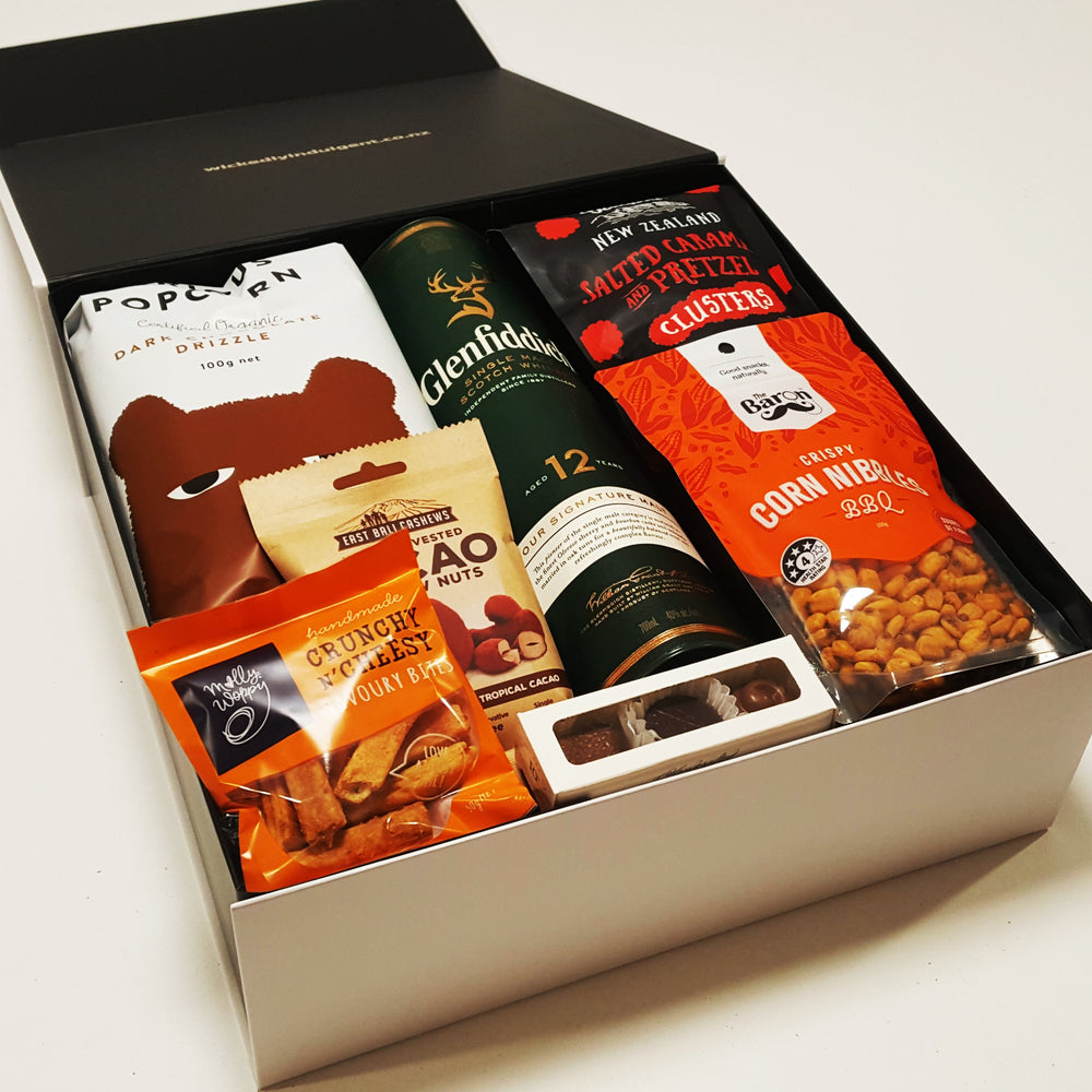 On the Rocks Corporate gift basket with whisky, chocolate, nuts and popcorn all presented in a modern gift box.