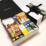 Plum paired with cheese gift basket. Cheese, Condiments and nibbles all presented in a modern gift box.