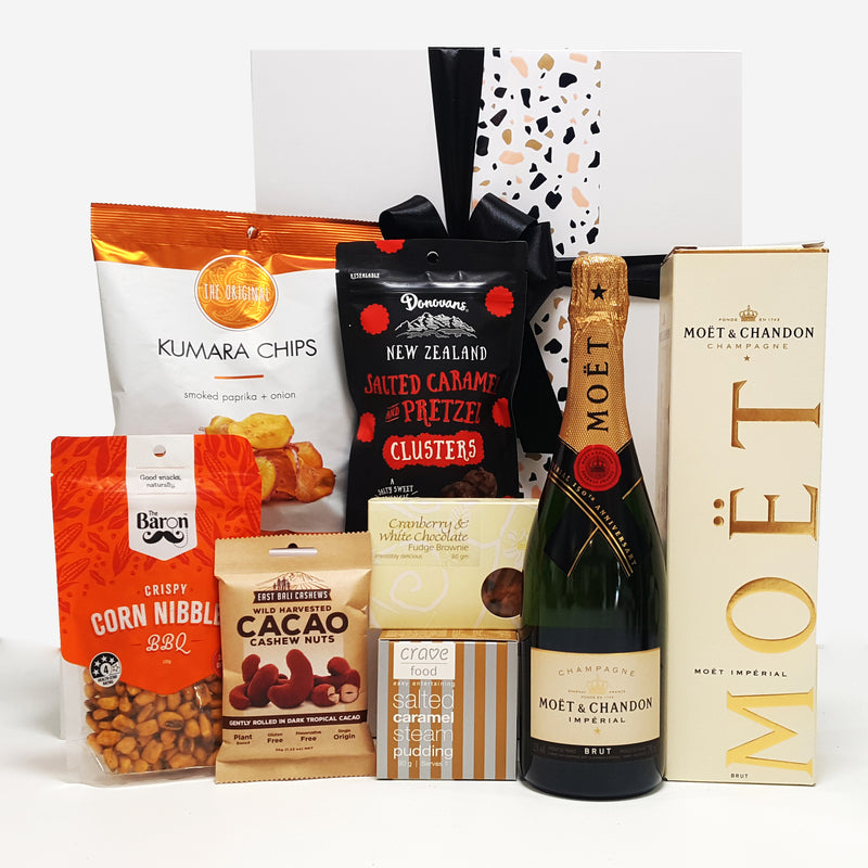 Pop. Fizz. Clink gift basket with No.1 Assemble bubbles and sweet & savoury nibbles.