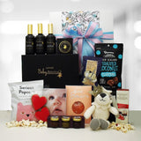Prince baby pamper gift box with baby lotions, soft toy and delicious food.