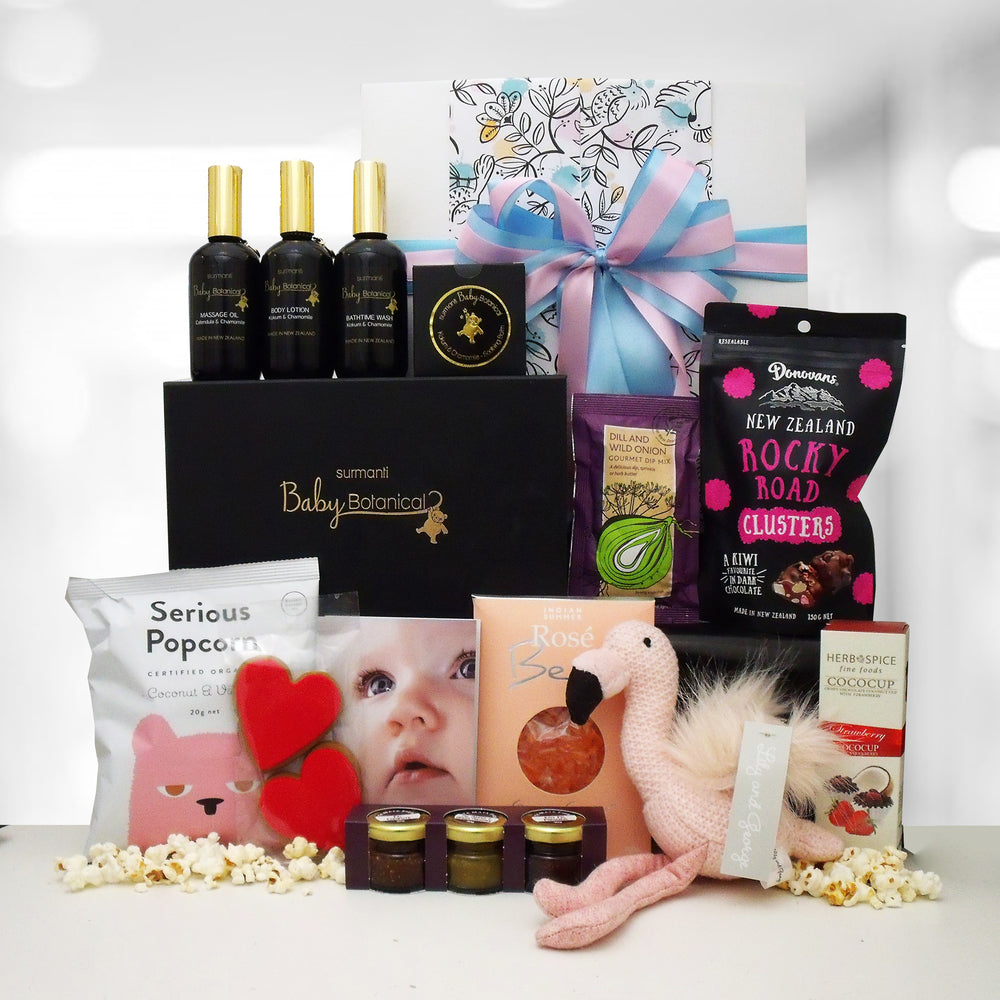Princess baby pamper gift box with baby lotions, soft toy and delicious food.