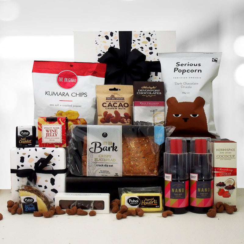 Priorities gift basket. Wine, cheese, wine jelly, chocolate & nibbles presented in a modern gift box.