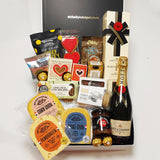 Simply the Best Champagne gift basket with Cheese, Chutney, Chocolate, Olives, Nuts & more all presented in a modern Gift Box.