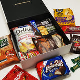 Snack Attack gift basket with M&M's, MallowPuffs, Maltesers, Toffee Pops & More presented in a modern gift box.