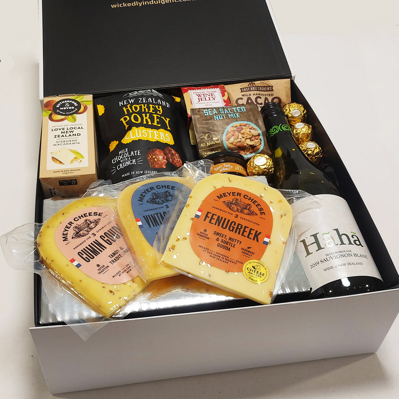 Tasty Treats Gift Basket with Cheese & Condiments, Wine, Nuts & Chocolate presented in a Gift Box