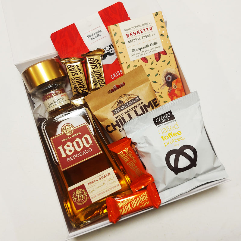 1800 Reposado Tequila Gift Basket with nibbles presented in a modern Gift Box.