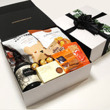 Kraken rum gift hamper with kumara chips, popcorn, nuts, brownie and cheesy bites all presentde in a modern gift box.