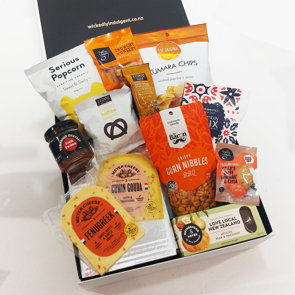 The grazing gift box with cheese, tamarillo chutney, chips, popcorn, pretzels & more.