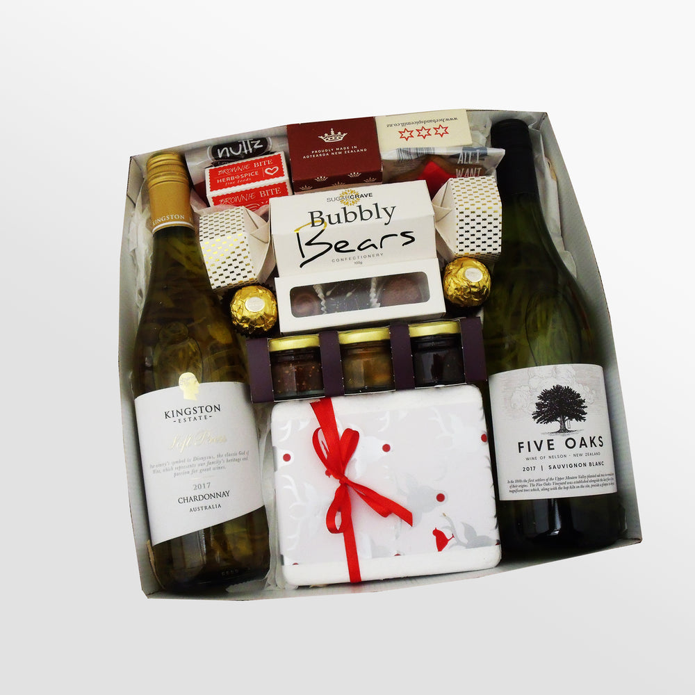 Christmas gift basket with two white wines, cheese, chocolate and a Xmas cracker. Presented in a modern gift box.