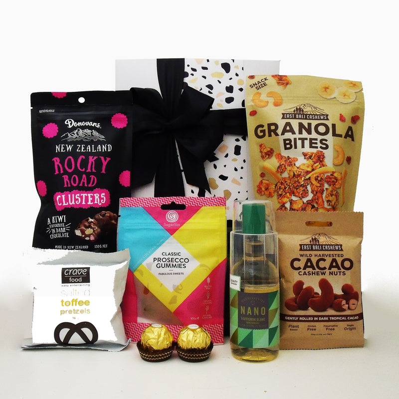 wine for one gift basket with granola bites, lollies, chocolate, nuts and more.