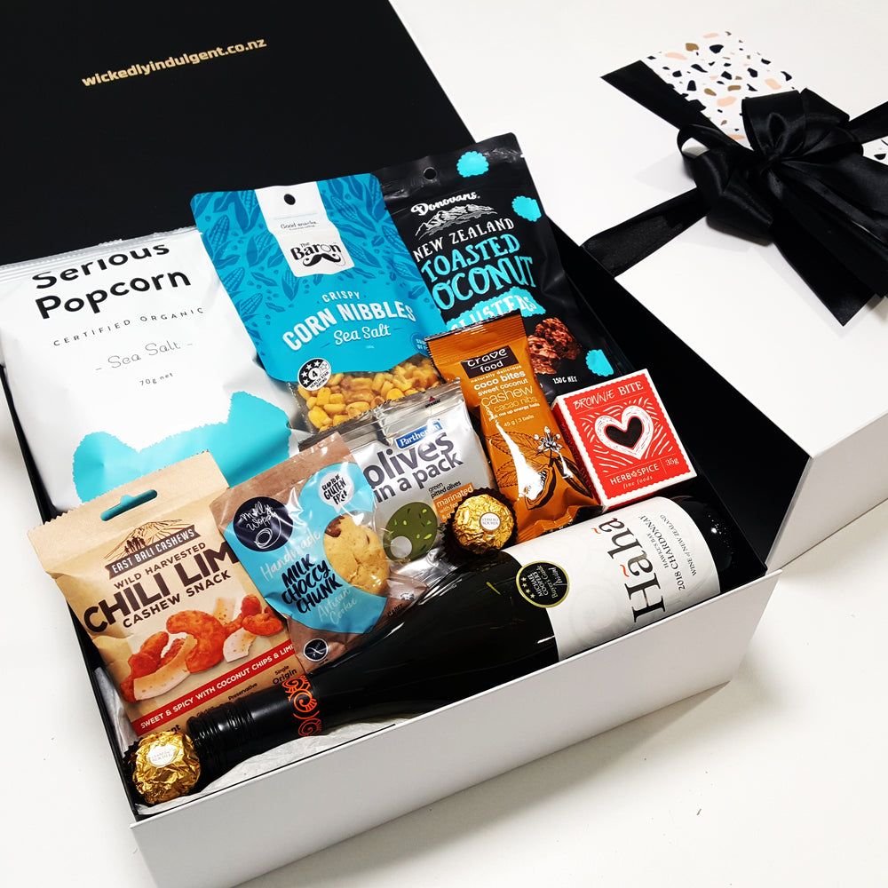 Wine O'Clock gift basket with Wine, Bliss Balls, Chocolate, nuts & Popcorn all presented in a modern gift Box.