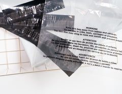 Clear poly bag with suffocation warning printed in black