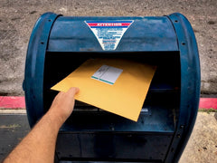 Mailing a package at a USPS mail drop box