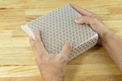 Man holding bubble wrapped box