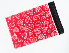 Red poly mailer with white hearts