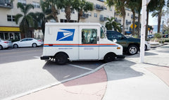 USPS making deliveries in a city