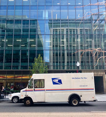 USPS truck a the city delivering mail