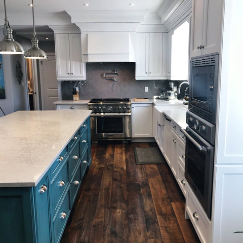 Kitchen walkway with island and stove