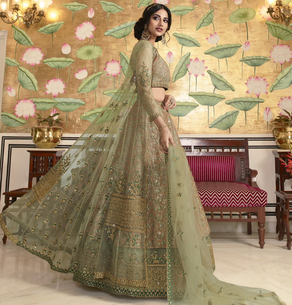 Aqua Green Color Net Exquisite Party Wear Lehengas NYF-6173