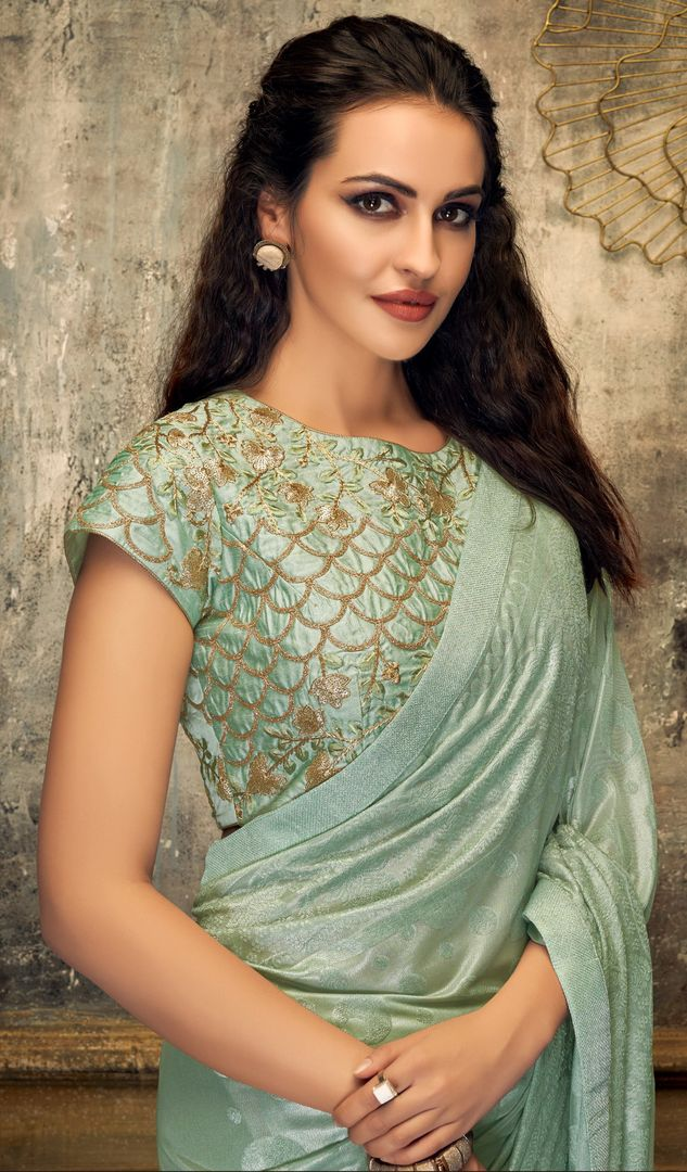 Aqua Green Color Embossed lycra Trendy Party Wear Sarees NYF-4387