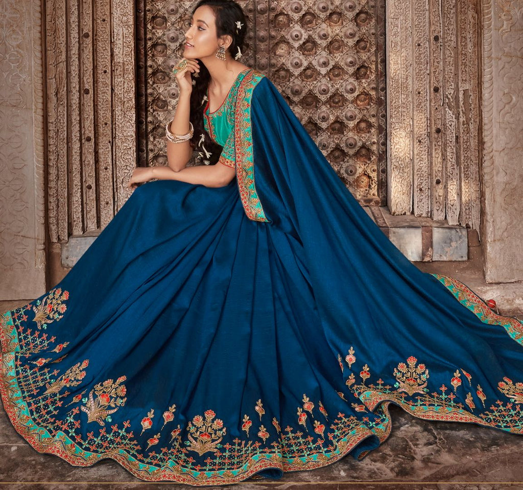 Blue Color Raw Silk Dazzling Party Wear Sarees NYF-4831