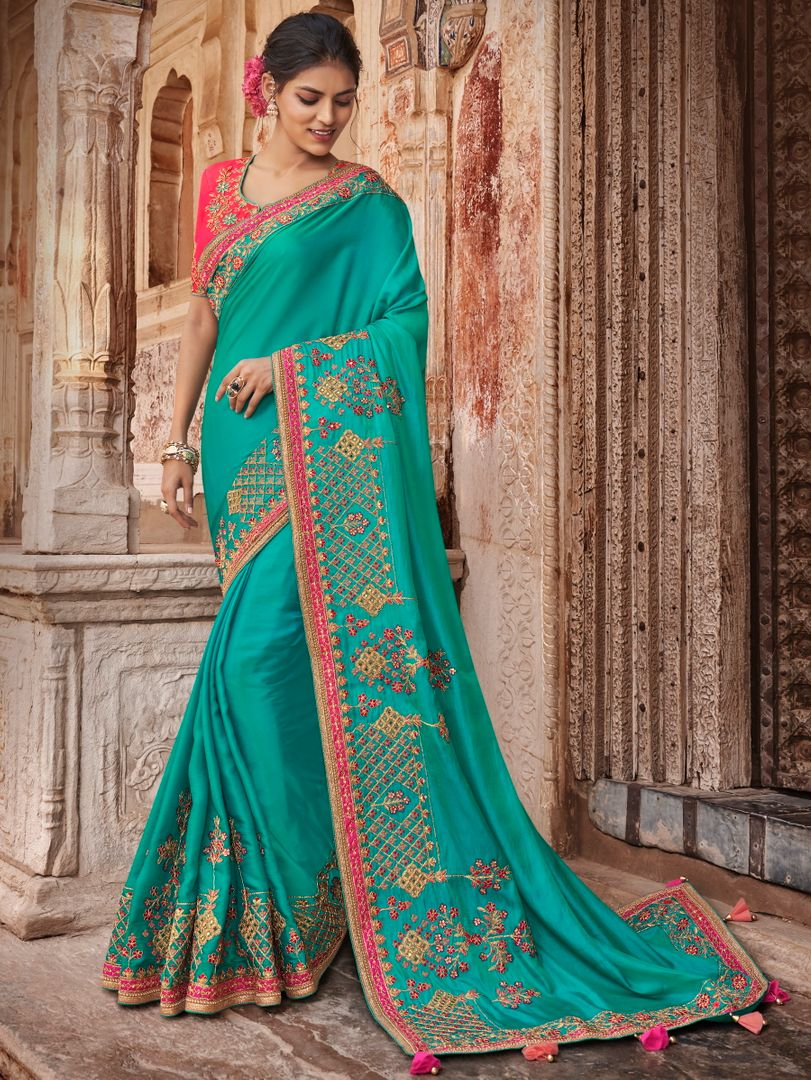 Aqua Blue Color Raw Silk Dazzling Party Wear Sarees NYF-4833
