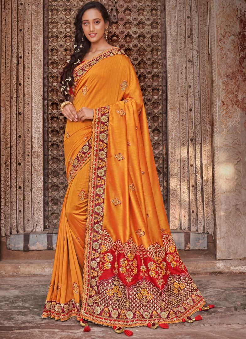 Mango Yellow Color Raw Silk Dazzling Party Wear Sarees NYF-4834