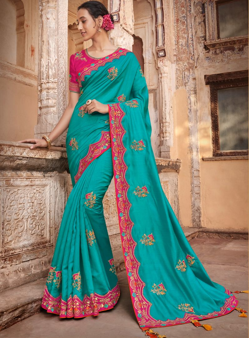 Firozi Color Raw Silk Dazzling Party Wear Sarees NYF-4835