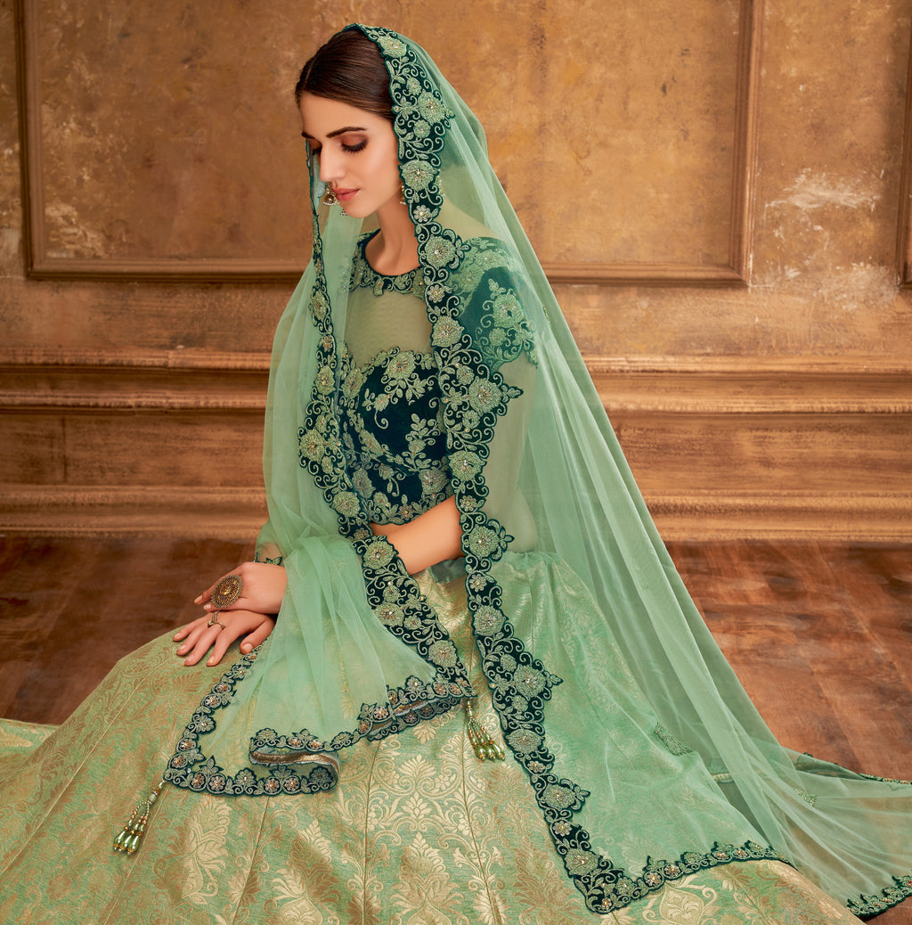 Aqua Green Color Weaving Silk Glamorous Party Wear Lehengas NYF-5830