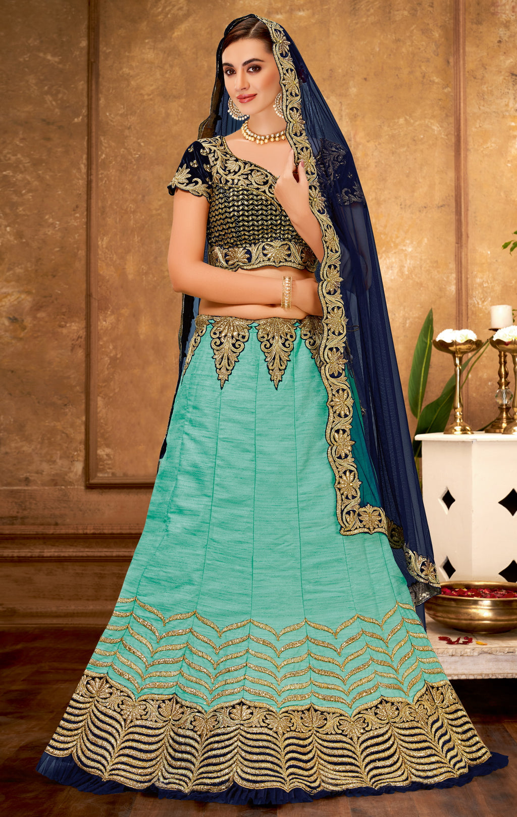 Aqua Blue Color Raw Silk Glamorous Party Wear Lehengas NYF-5839