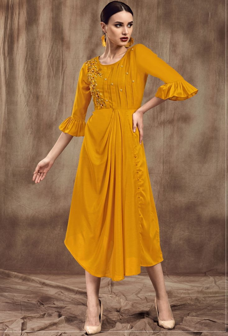 Mustard Yellow Color Muslin Trendy Party Wear Kurtis NYF-4869