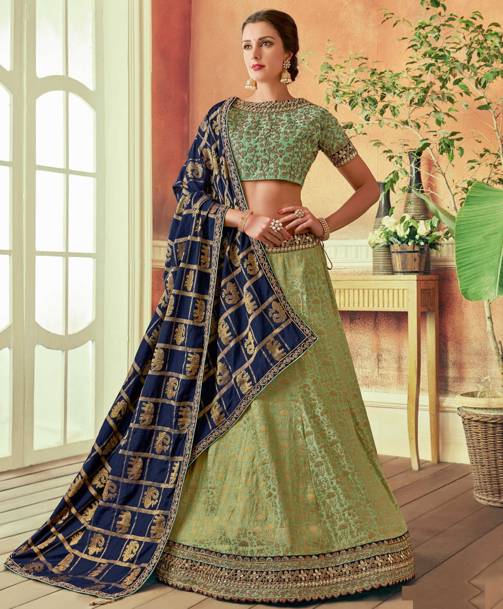 Green Color Weaved Silk Beautiful Wedding Wear Lehengas NYF-5549