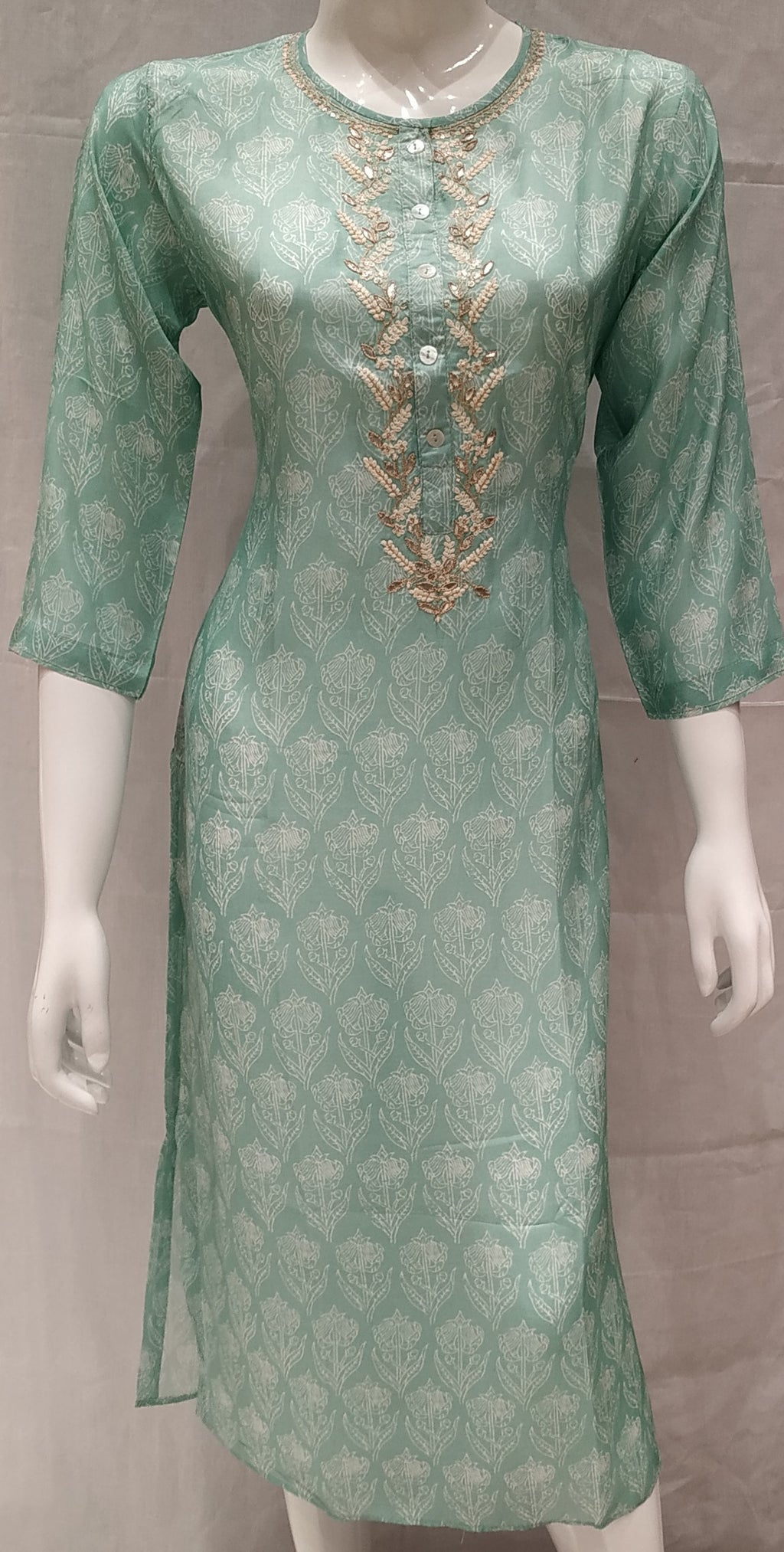 Green Color Pure Muslin Designer Party Wear Kurtis NYF-6613