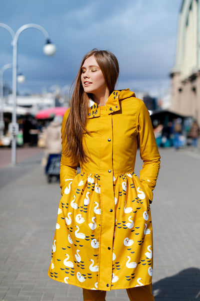 Mustard raincoat with Swans printed skirt