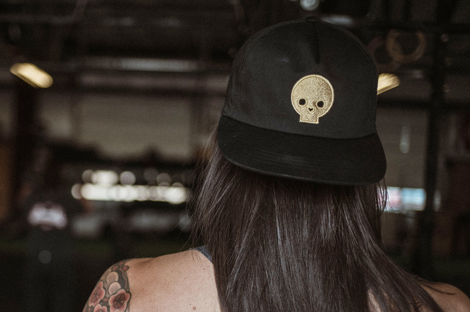 OG unstructured black hat with gold skull by Auya Co.