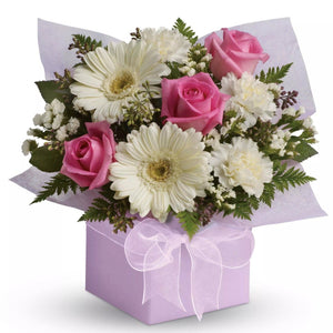One of our best selling Beauties! This lady like arrangement of pure gerberas, roses and carnations.