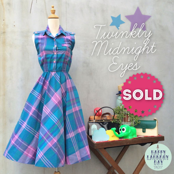 Twinkly Midnight Eyes | Vintage 1950s plaid dress in pink purple and blues with Pockets