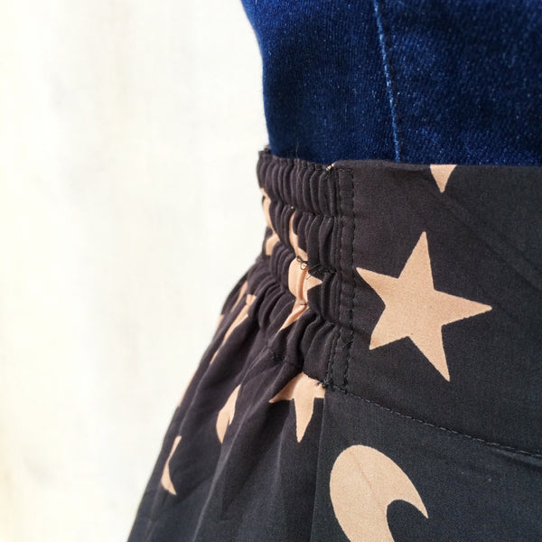 Wicked! | Vintage 1970s 1980s magical Stars and Moon Wizard print Black skirt