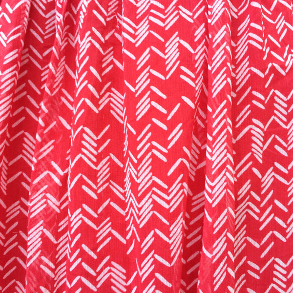 Raspberry Ruby | Vintage 1960s 1970s flirty red skirt with Pseudo herringbone print | White geometric print