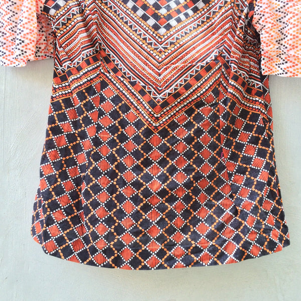 My Tribe | African ethnic Tribal print Short puff sleeve Vintage 1960s Orange Black geometric print Top