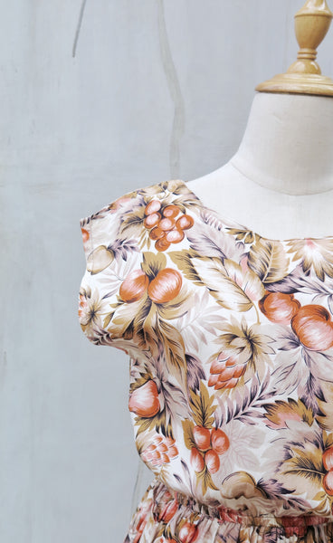Brindi | Vintage 1950s 1960s Chestnut browns autumn floral and tropical leaf print cotton dress