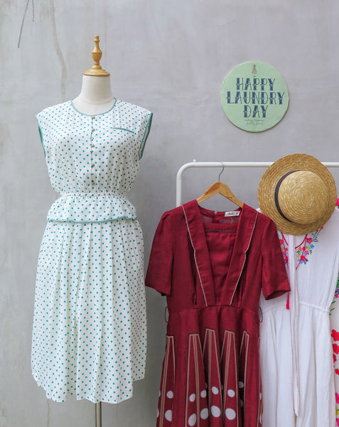 Emmie | Vintage 1970s 1980s emerald green polka dot peplum dress