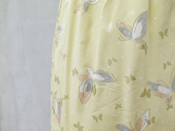 Hanamee | Vintage 1950s 1960s pastel yellow silky Dress with button back and butterfly print