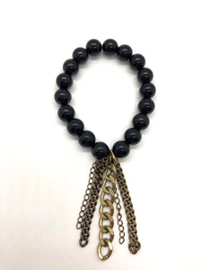 Black Onyx bead bracelet with chunky bronze chain tassel