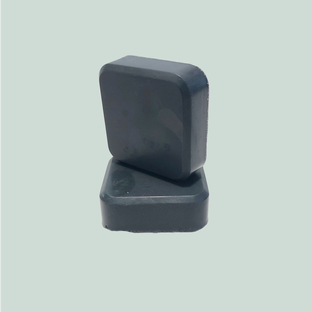 Handmade mini charcoal bar of soap made with lavender essential oil
