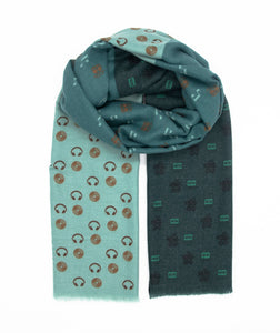 Cool scarf in three different shades of green such as mint, sea and dark green with a film score design including shapes of headphones, camcorder, music scores and vinyl record. Made of cosy and warm materials which makes it a perfect fit for the Winter, Autumn and Spring season. It will also keep you warm on a chilly day in Summer so you can simply wear it all year round! Scarves for men. Scarves for women.