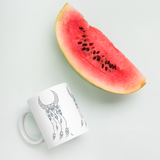 Sacred Geometry Feather Mug with watermelon for scale